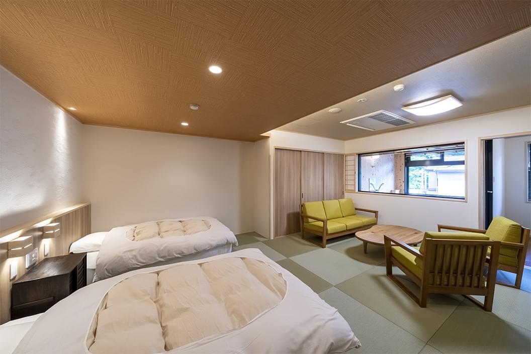 【605】かけ流し温泉付【和室ベッド】16畳|北向観音ビューの画像1